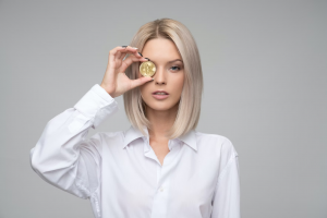 coin2play-a-lady-holding-coin